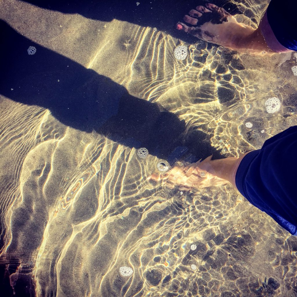 Image of Debra Gwartney's selfie of her feet in the Salmon River on a sunny day in Idaho